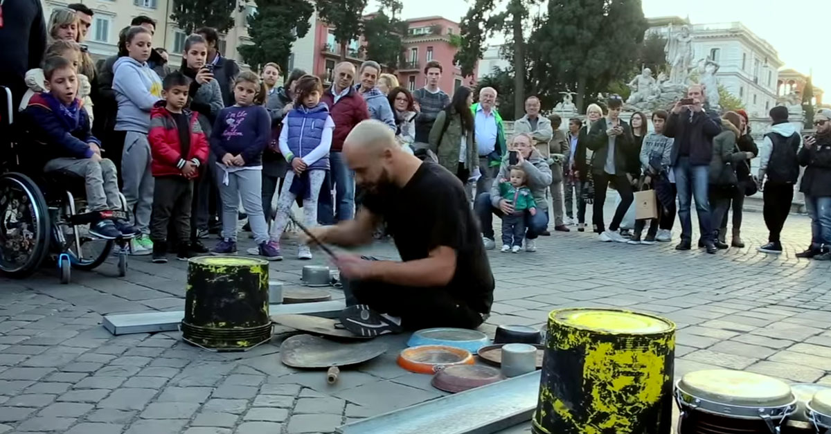 This street performer makes beautiful music out of pieces of junk