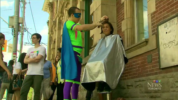 Man dresses like a superhero to give free haircuts on the street