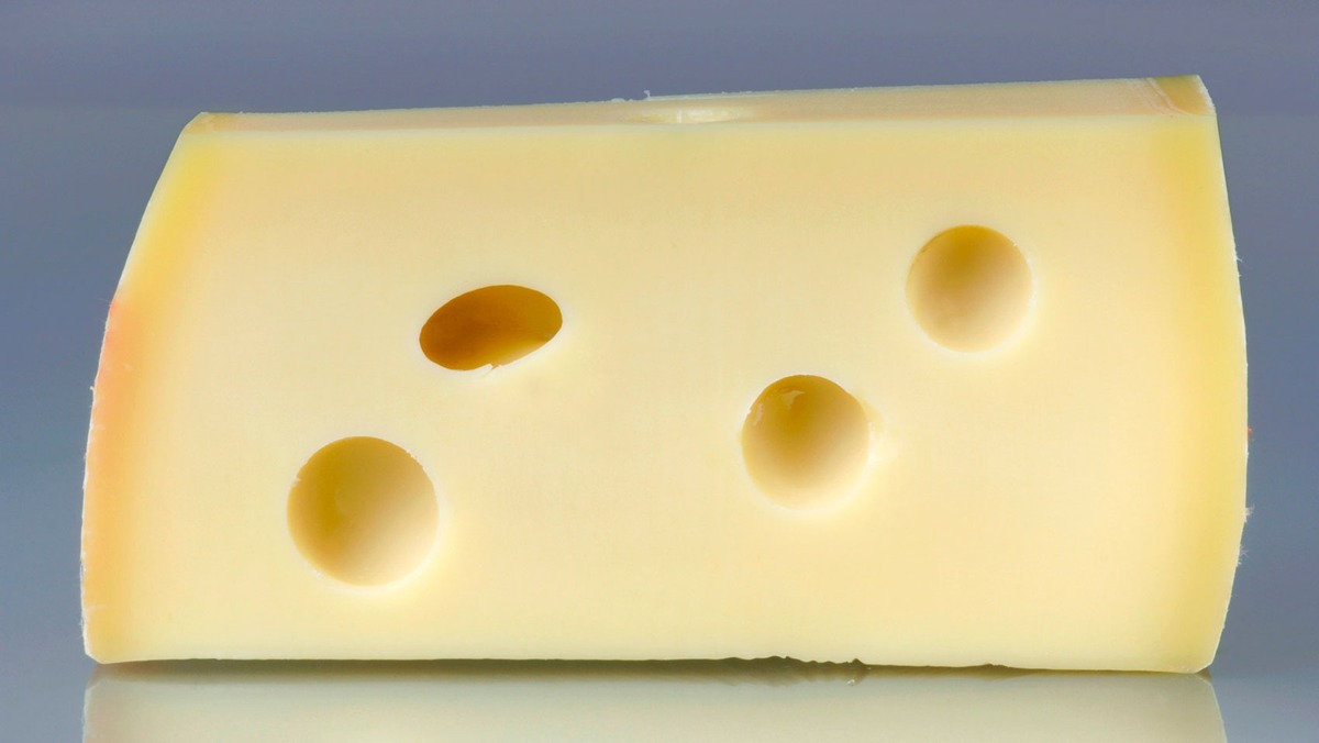 Mystery of holes in Swiss cheese finally solved