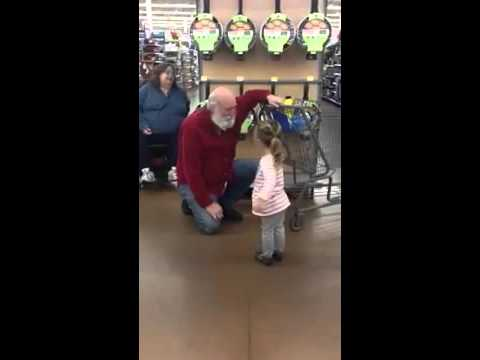 Little Girl Mistakes A Stranger For Santa And He Rolls With It