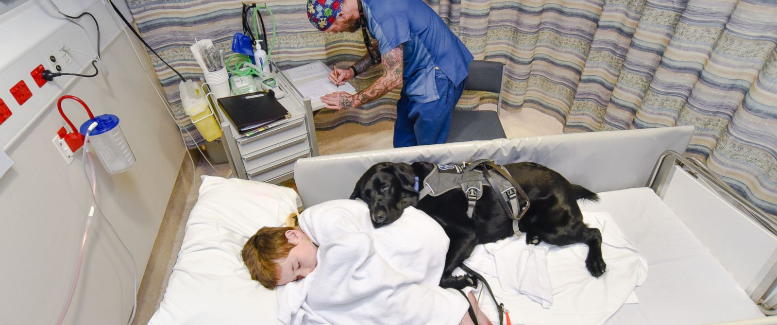 Loyal Dog Jumps on Hospital Bed to Comfort 9-Year-Old Boy With Autism