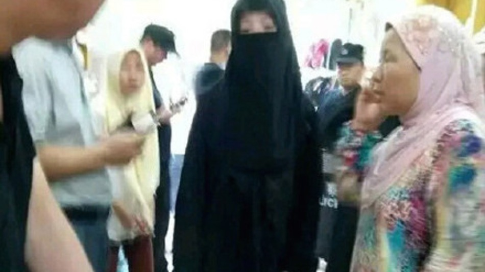 Chinese police arrest women wearing burqas in Henan