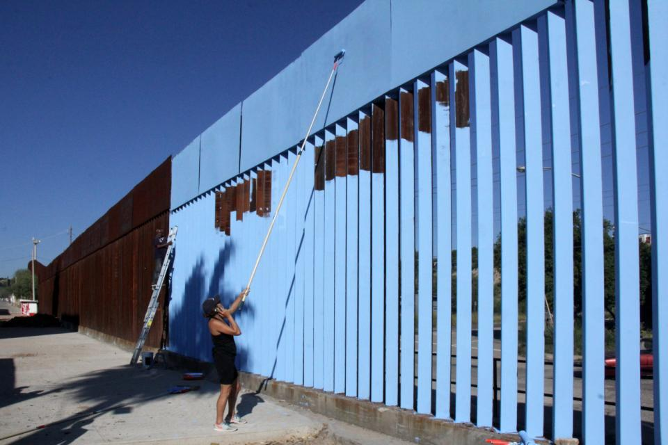Why an artist painted a U.S.-Mexico border fence sky blue